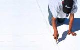 Precision Roofing Staff Checking Seams